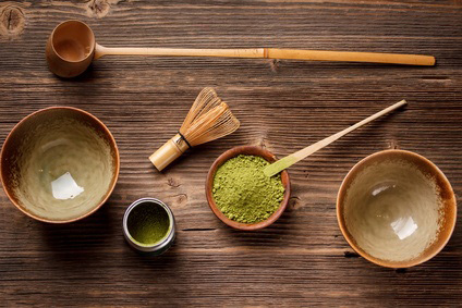 Bowls of matcha ppwder on a wooden table