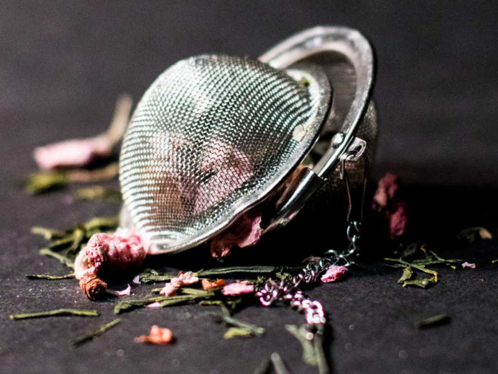 Tea infuser with holes large enough for water to pass through