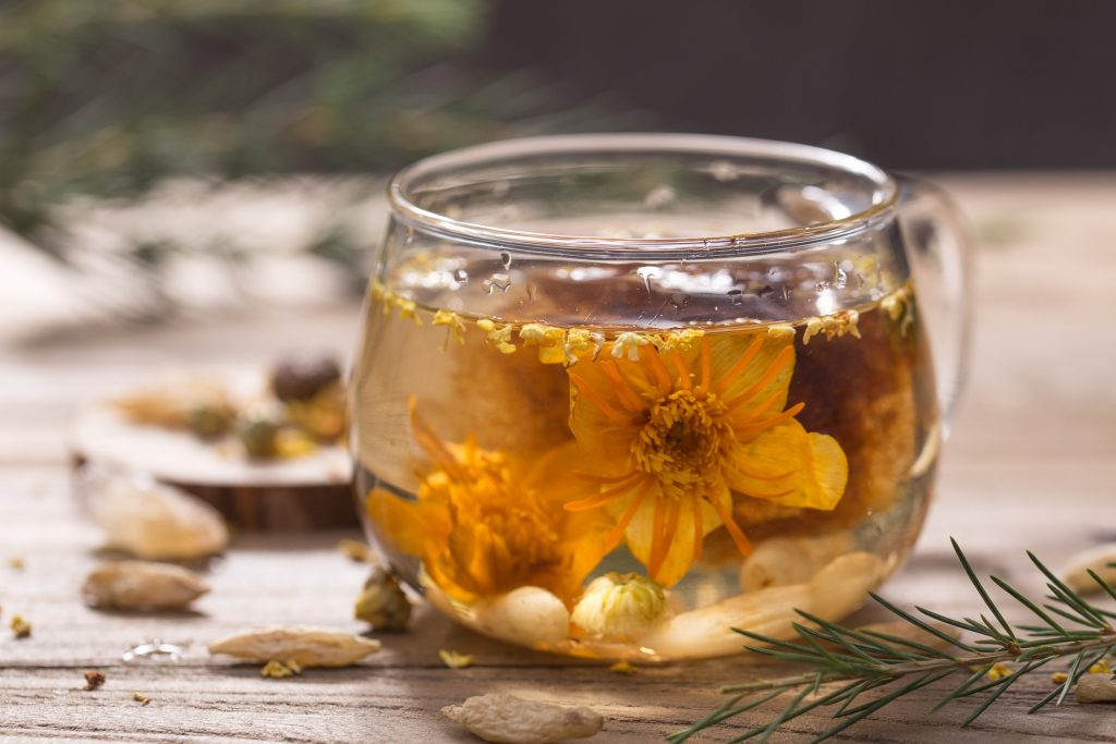 Steeping fresh jasmine flower in a clear glass cup