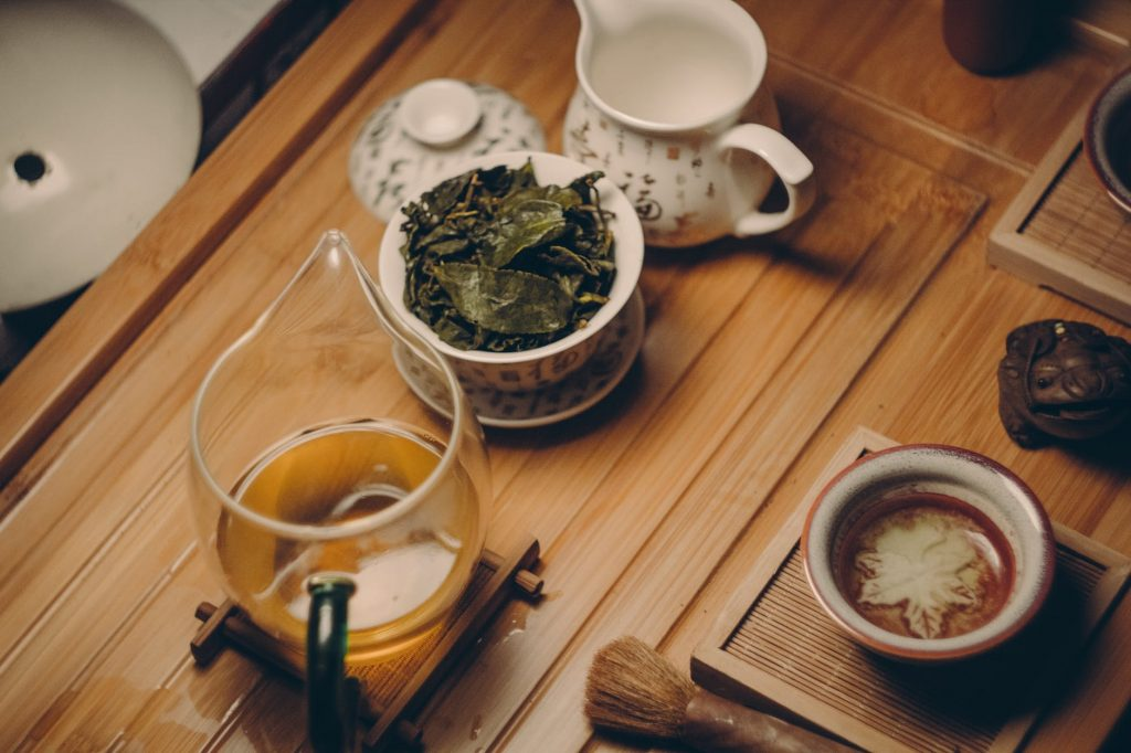 Tea leaves in a cup on a wooden table