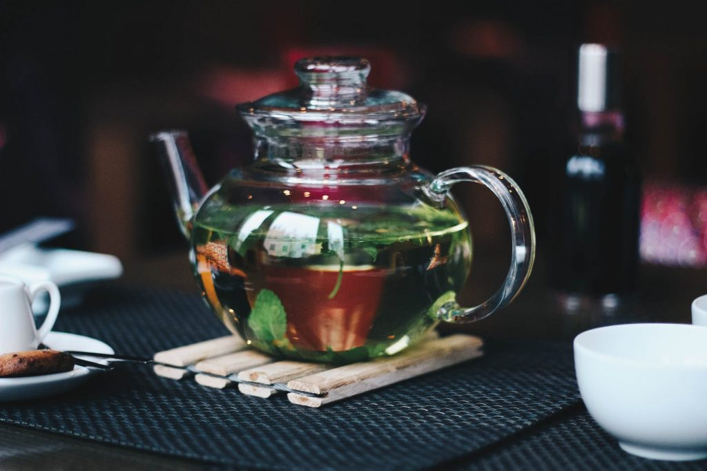 A glass teapot with brewed tea