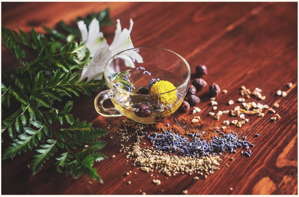 A cup of herbal tea on wooden surface