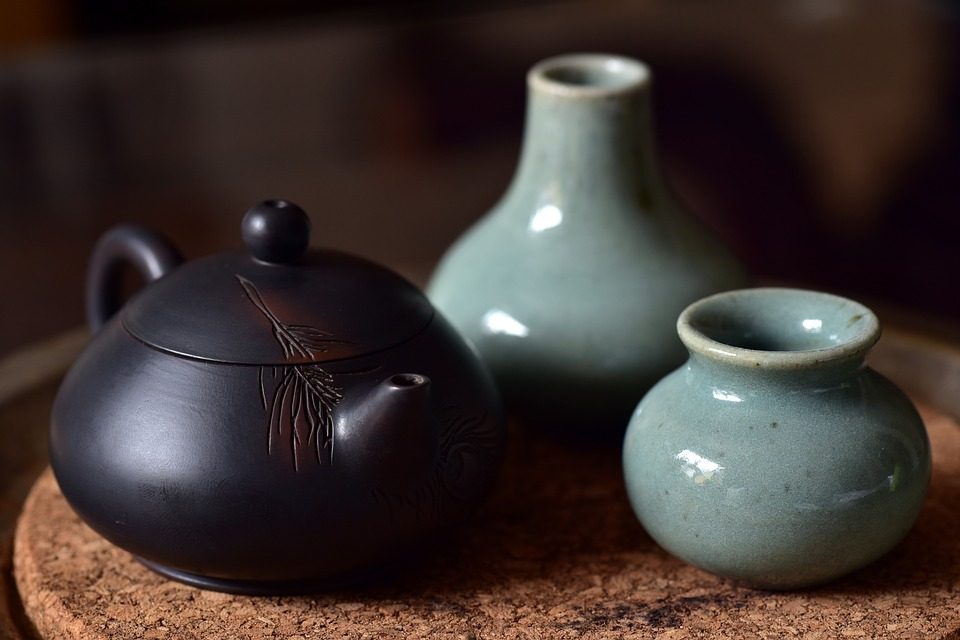 Chinese teapot and blue jars on a tray