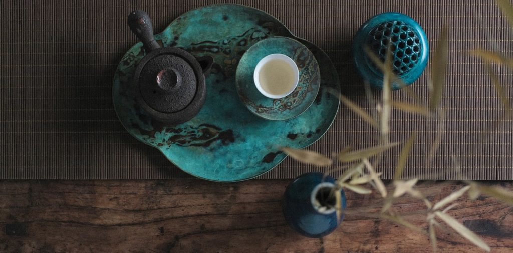 A teapot and a cup of oolong tea on a tray