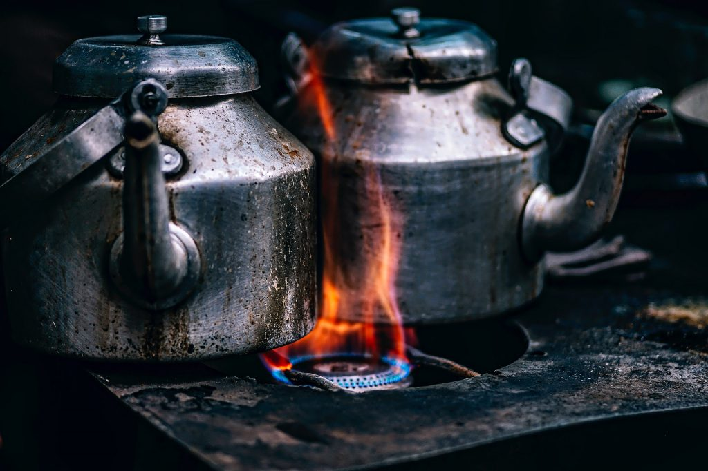 Herbal tea being boiled in a kettle on a gas stove