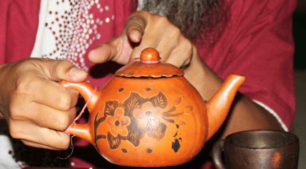 Tea being steeped inside a teapot
