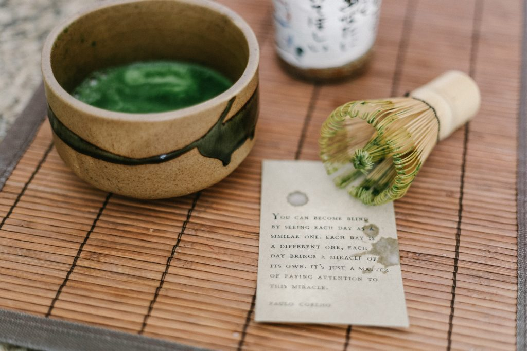 Matcha tea prepared with a bamboo whisk