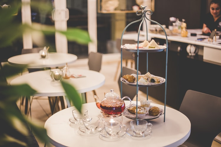 Afternoon tea being served with various kinds of snacks