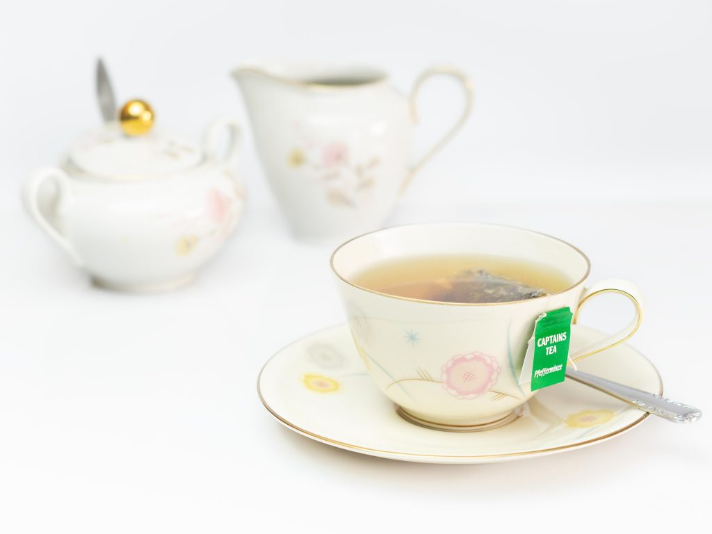 Mint tea bag steeped in a hot cup of water