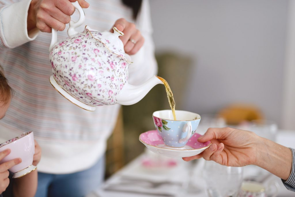 Woman pouring tea into cup