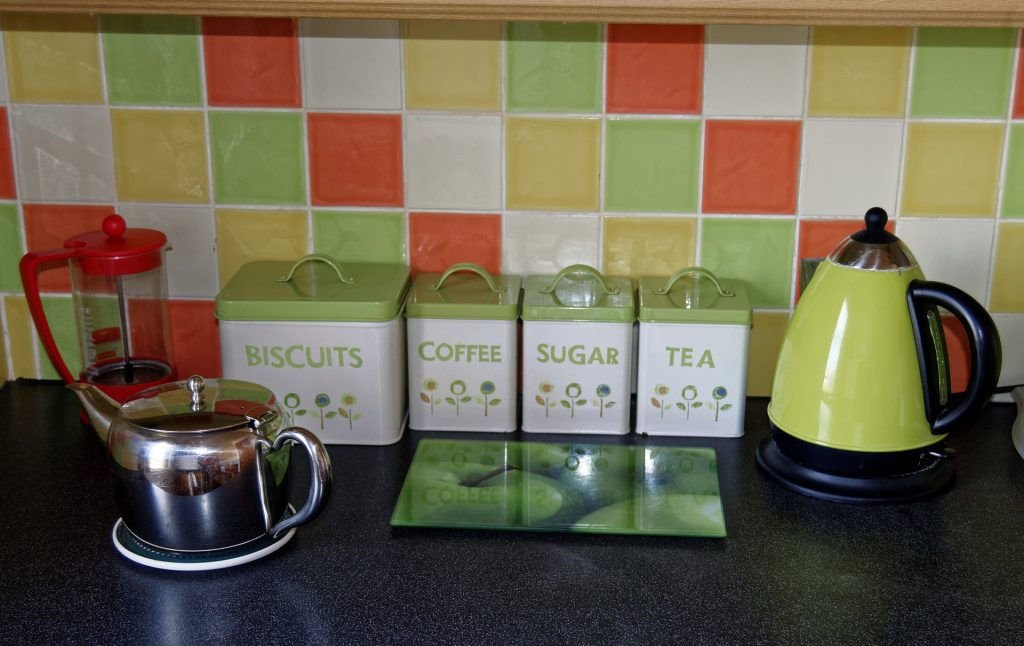 Clean tea kettle and electric kettle on the counter
